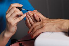 Manicure master at work - stock photo