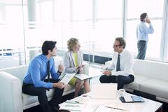 Business people talking in office lobby Stock Photos