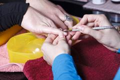 Manicure master at work Stock Photos
