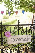 'Reception' sign on wrought iron fence Stock Photos