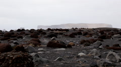 Volcanic black beach in iceland with strange rock formations in iceland with sea Stock Footage