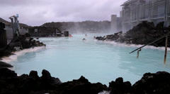 People swimming blue lagoon iceland in geo thermals Stock Footage