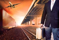 Business man with metal breifcase investment  standing against airpalne ,trai Stock Photos