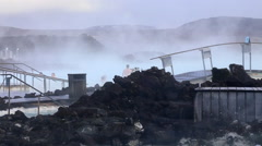 Blue lagoon iceland geo thermal steam with volcanic rock Stock Footage