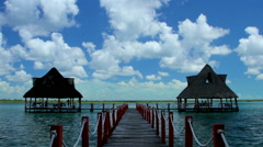 Time-lapse, people enjoying and resting in a bungalow, in Bakalar's lagoon. Stock Footage
