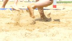 Beach volleyball player legs sand box Stock Footage