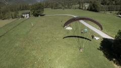 Aerial view of paraglider landing. Spain Stock Footage