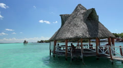 People enjoying and resting in a bungalow, in Bakalar's lagoon. Stock Footage