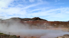 Strokkur Geysirs with mountains in background and geo thermals Stock Footage