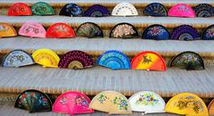 Spanish colorful fans  in the exhibition for  sale Stock Photos