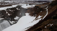 Gullfoss waterfall wide with rocks and snow in iceland Stock Footage