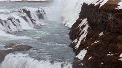 Gullfoss waterfall wide in spring with snow and rocks in Iceland Stock Footage