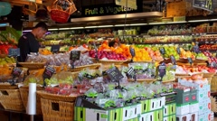 Buyers Choosing Fresh Fruits at a Market. Speed up Stock Footage
