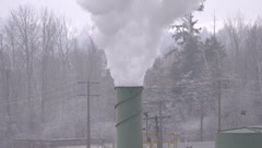 Winter steam exhaust lumber plant, tight shot Stock Footage