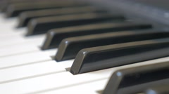 Piano keys close-up panning 4K 2160p UHD footage - Electric piano black and w Stock Footage