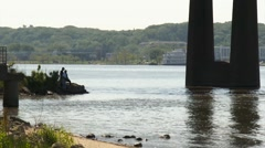 Fishing on the bank of the Mississippi River - Wide Shot - stock footage