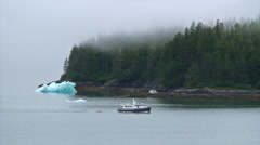 Boat on mist filled Tracy Arm fjord in Alaska Stock Footage