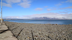 Mountain with blue sky at seafront in Reykjavik, Iceland Stock Footage