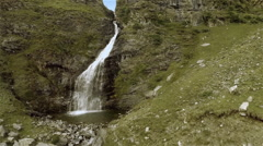 Aerial view of a waterfall in the mountains. Spain Stock Footage