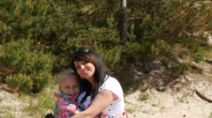 Happy daughter and mother posing outdoors Stock Footage