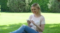 Young teen age beautiful lovely girl relax chatting sliding her smartphone Stock Footage