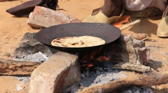 Video 1920x1080  Indian chapatti on fire, Pushkar, India Stock Footage