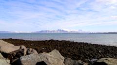 Rocks sea mountain sky iceland Stock Footage