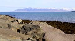 Rocks sea mountain sky Stock Footage