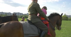 Little Girls Are Riding Horses Celebration of European Victory`s Day in Poland Stock Footage