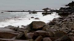 Rocks sea energy pipe Stock Footage