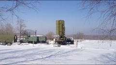 Green military radar station rotates in winter. - stock footage