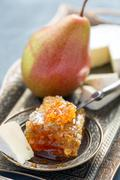 Brie cheese, honey and pear. Stock Photos