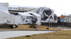 Street art on buildings in iceland with roundabout Stock Footage