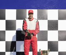 Racer opening champagne at award ceremony Kuvituskuvat