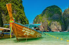 Colorful long tail boat at Maya Bay heavenly beach - stock photo