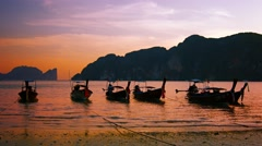 Handmade, Wooden Tour Boats on the Beach at Sunset Stock Footage