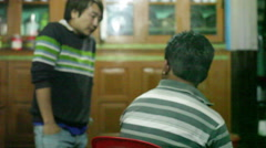 People inside a Sikkim house in the Himalayas, medium shot, shallow DOF Stock Footage