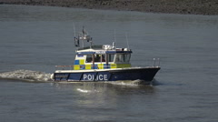 London River Thames Police patrol boat, England Stock Footage