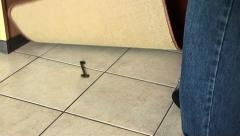 Man is hiding a house key under the mat Stock Footage