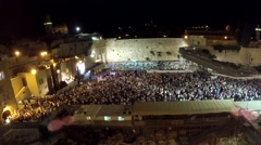 4K, Masses of people by night at the western wall (time lapse) - stock footage