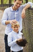 Father and son in baseball field Stock Photos