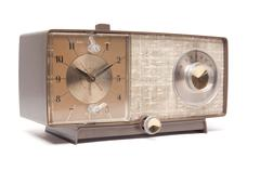 Vintage Clock Radio Isolated Facing Right on a White Background. Stock Photos