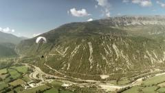 Aerial view of a paraglider flying next to a mountain. Spain. 60 fps Stock Footage