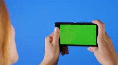 Taking photos in front of blue screen 4K 2160p UHD footage - Chroma green scr Stock Footage