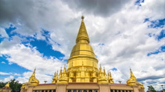 Golden Pagoda Sri Vieng Chai Of Lamphun, Thailand (pan shot) Stock Footage