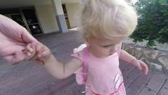 Little girl out of the house. Slow motion. Stock Footage
