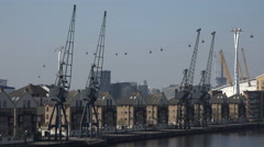 Houses along docklands waterfront and Emirates Cable car, London, England Stock Footage
