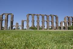 Aqueduct of Merida from the grass Stock Photos