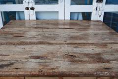 Wood Table Against Old Door - stock photo