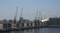 Waterfront houses in London docklands, Emirates Cable car, England Stock Footage